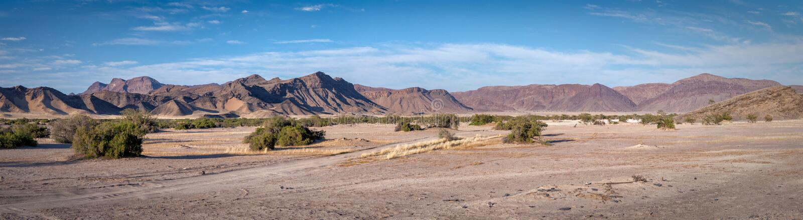 Palmwag Concession desert panoramic view. Panoramic view of the desert landscape Palmwag Concession in Namibia royalty free stock photo