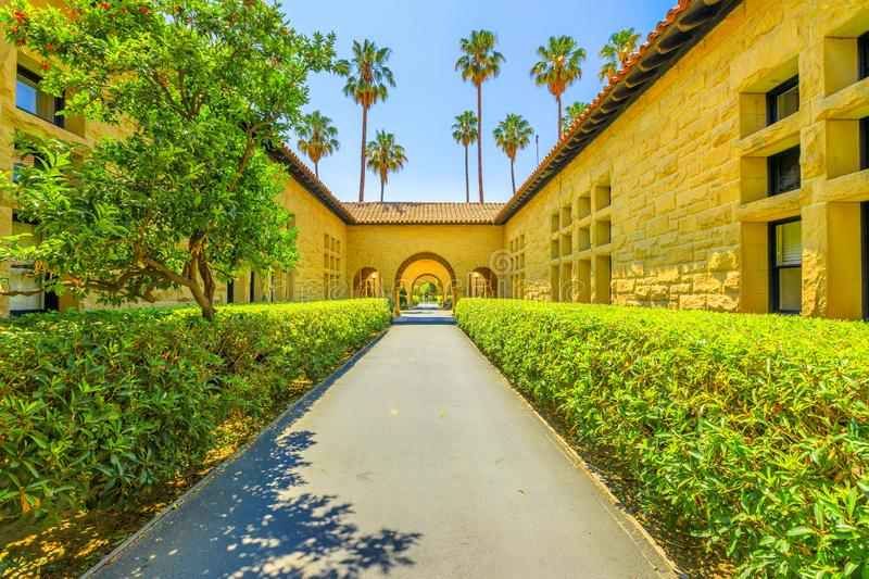 Stanford Gate Palo Alto. Palo Alto, California, United States - August 13, 2018: Gate to Main Quad at Stanford University Campus, one of the most prestigious stock photography