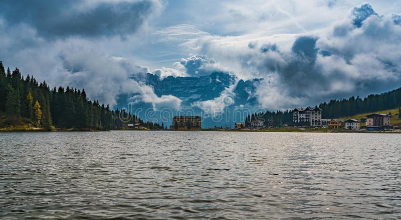View of Misurina Lake with Dolomite mountain in dramatic cloud, Belluno, Italy. View of Misurina Lake with Dolomite mountain range in dramatic cloud, Belluno royalty free stock photos