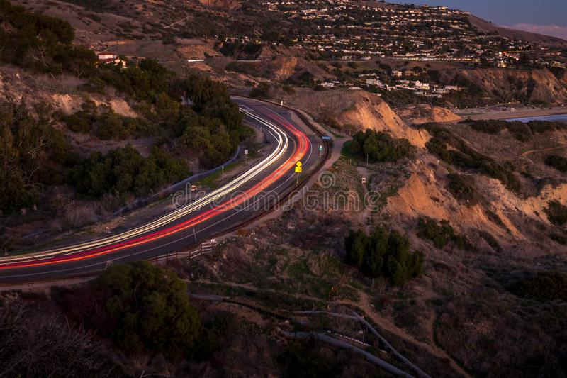 Palos Verdes Drive after Sunset. Long exposure photo of light streaks from cars driving along coastal Palos Verdes Drive, Rancho Palos Verdes, California royalty free stock image