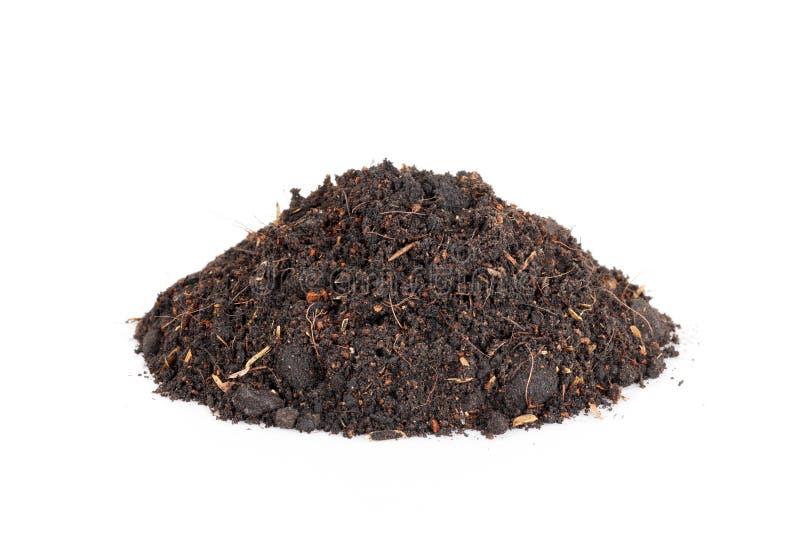 Palowy rozsypisko glebowy czarnoziem odizolowywający na białym tle obrazy royalty free