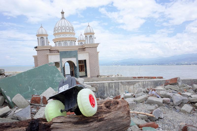 Tsunami and Earthquake in Indonesia. PALU, INDONESIA - OCTOBER 11th, 2018: A partially submerged mosque that has been knocked off its foundations by an stock image