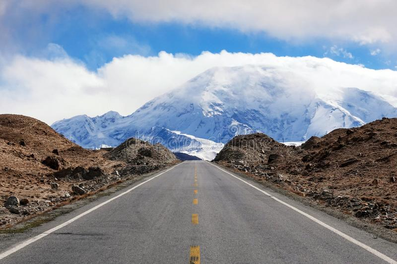 Road to Muztagata Mountain on Pamirs. The Pamir Mountains, or the Pamirs, are a mountain range in Central Asia at the junction of the Himalayas with the Tian stock images