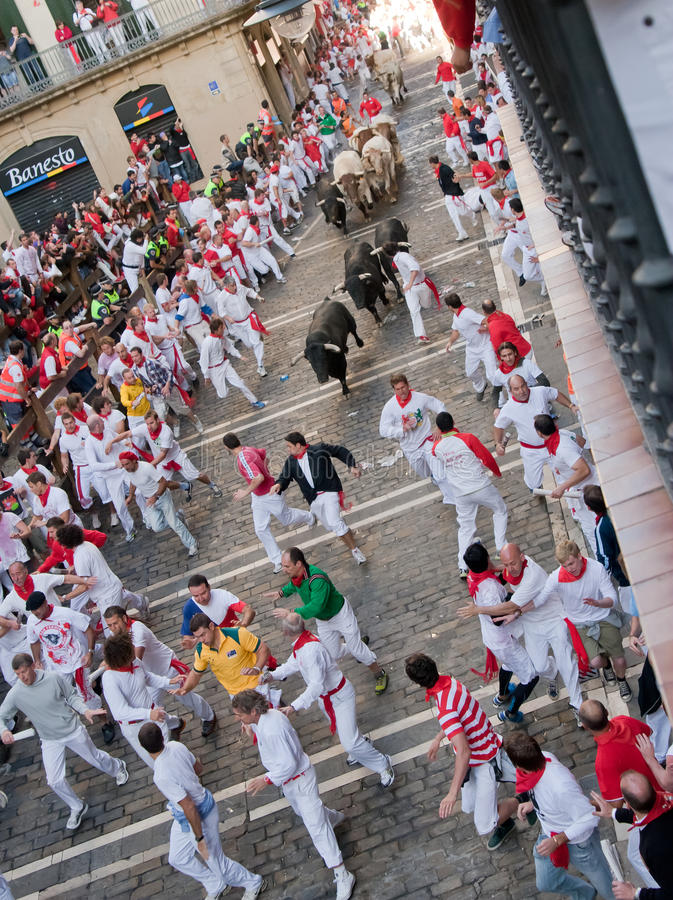 Download PAMPLONA, SPAIN -JULY 8: Bulls Run Down The Street Editorial Photography - Image: 21618427