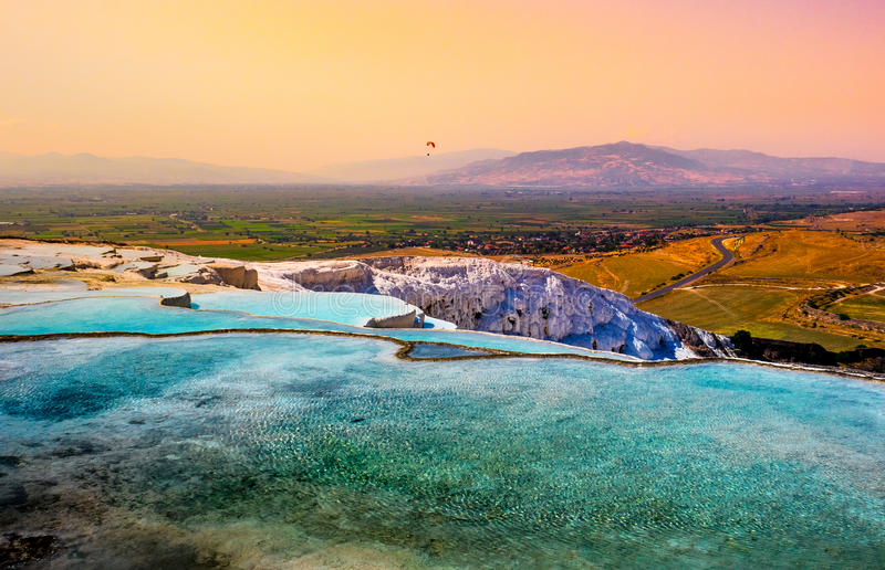 Pamukkale landscape. Thermal springs and terraces on turkish resort Pamukkale. Natural reserve in Turkey - landscape with water cascade of travertines at sunset royalty free stock photography