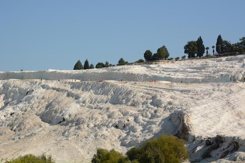 View of travertine terraces at Pamukkale. Denizli province. Turkey. Pamukkale, meaning cotton castle in Turkish, is a natural site in Denizli in southwestern stock image