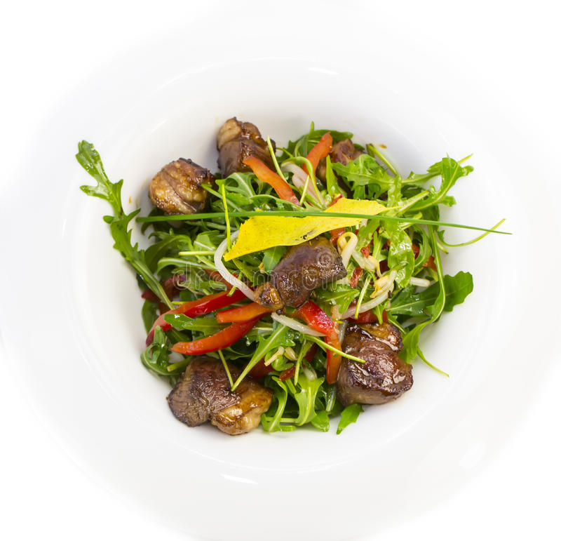 Pan-Asian cuisine. Duck with arugula on a white background in the restaurant royalty free stock photo