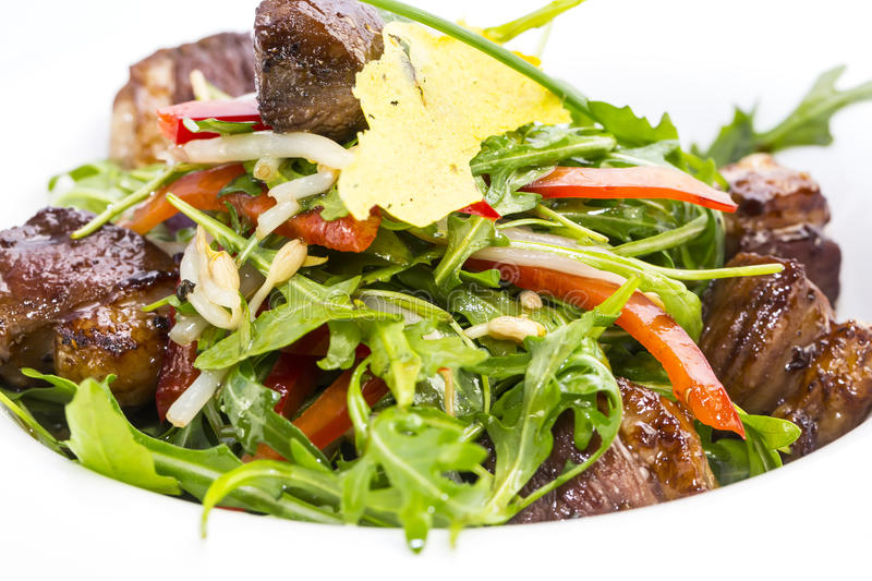 Pan-Asian cuisine. Duck with arugula on a white background in the restaurant stock image