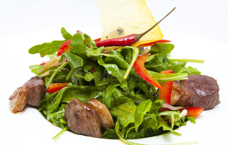 Pan-Asian cuisine. Duck with arugula on a white background in the restaurant stock photos