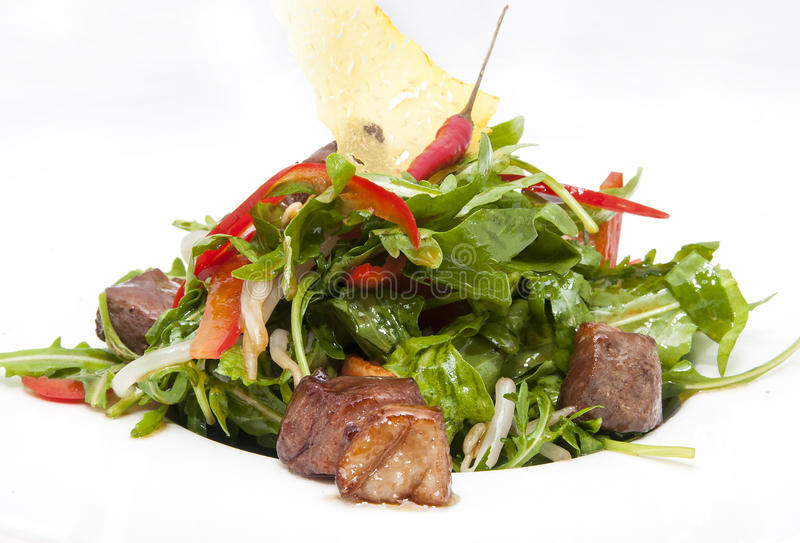 Pan-Asian cuisine. Duck with arugula on a white background in the restaurant stock photo