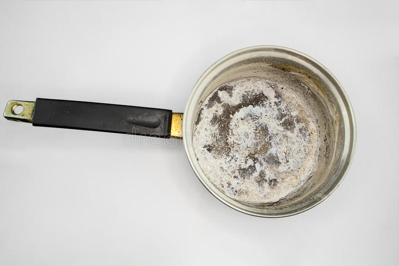 Pan burnt food white background. Pan with burnt food on white background royalty free stock photo