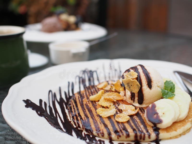 Pan cake and ice cream with chocolate syrup royalty free stock photos