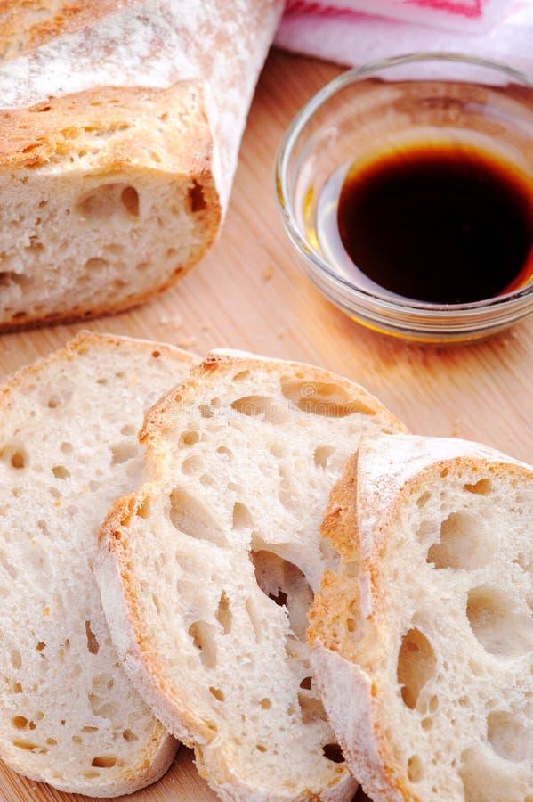 Pan con aceite de oliva imagen de archivo