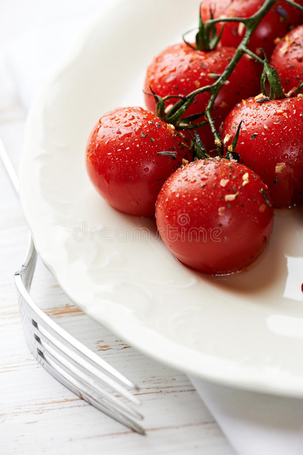 Download Pan Cooked Cherry Tomatoes On A Plate Stock Image - Image: 22023907