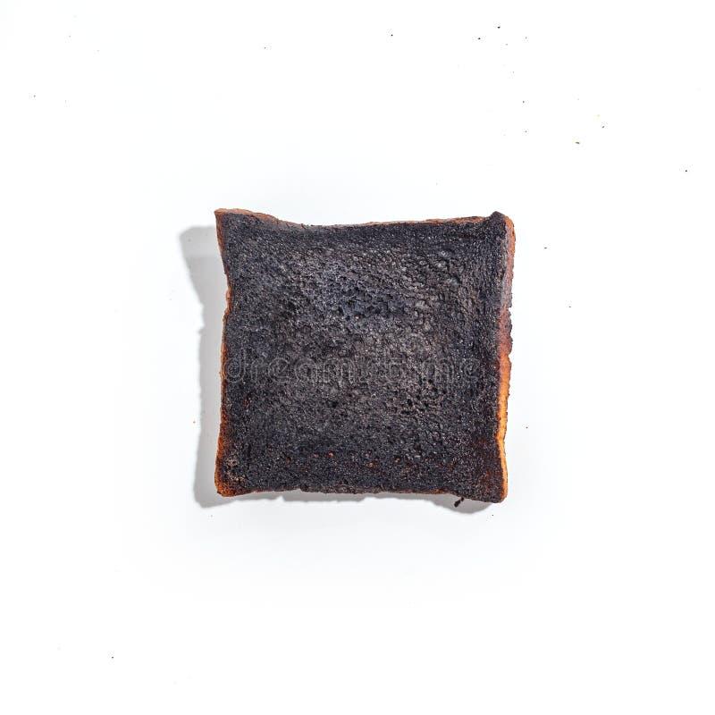 Pan cortado carbonizado quemado de la tostada aislado en el fondo blanco Visión superior fotografía de archivo libre de regalías