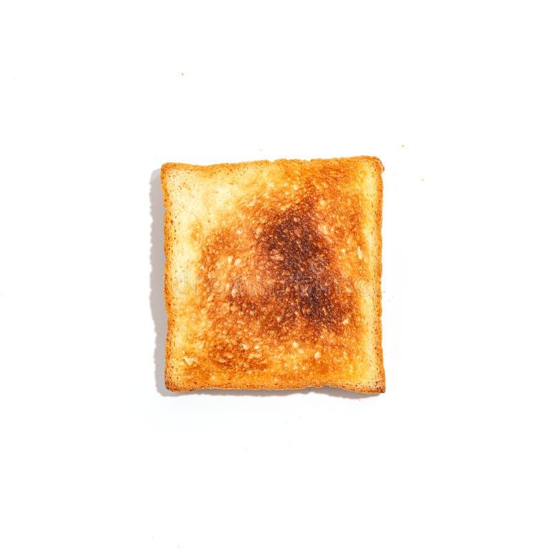 Pan cortado de la tostada aislado en el fondo blanco Visión superior foto de archivo