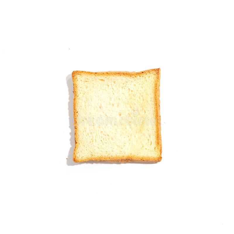 Pan cortado de la tostada aislado en el fondo blanco Visión superior imagenes de archivo