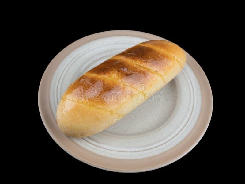 Pan de ajo aislado en el fondo negro con la trayectoria de recortes foto de archivo