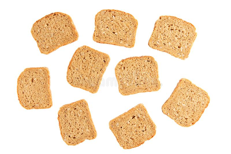 Pan de centeno tostado cortado aislante blanco foto de archivo libre de regalías