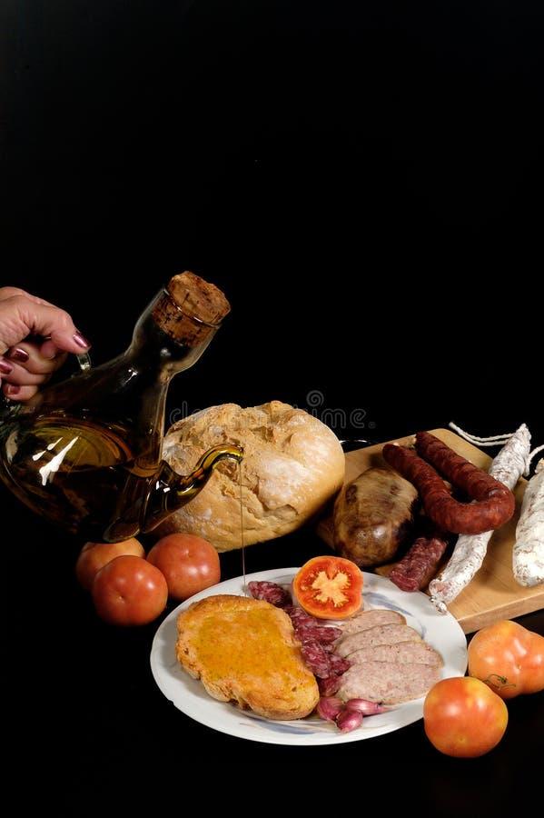 Pan del tomate con el catalan típico foto de archivo libre de regalías