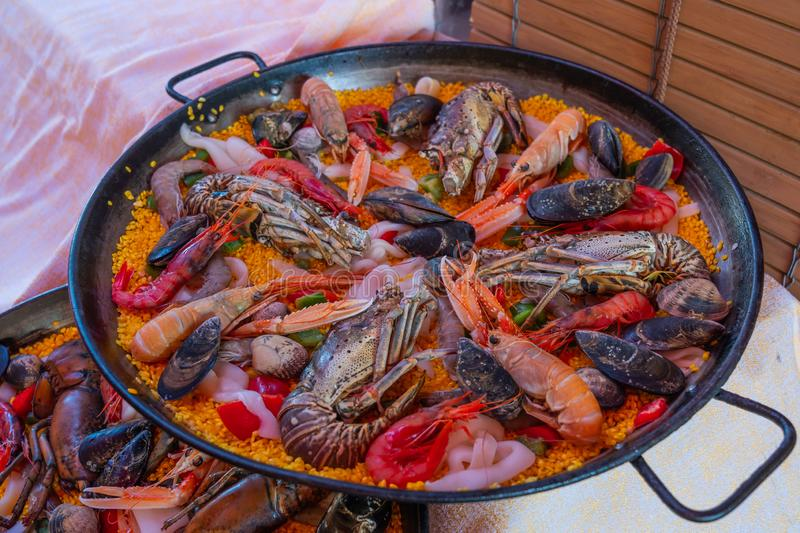 Pan of delicious paella traditional Spanish fried seafood rice stock photo