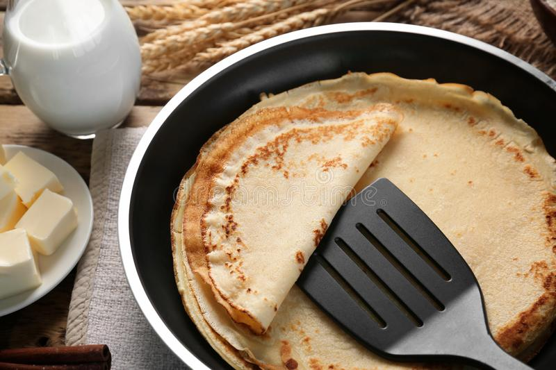 Pan with delicious pancakes royalty free stock photo