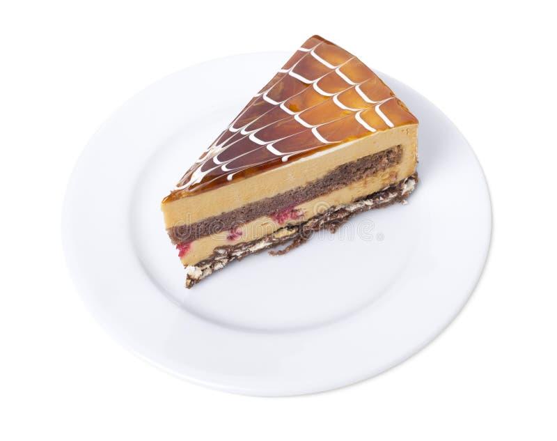 Pan di Spagna delizioso del budino del cappuccino in un piatto bianco fotografia stock libera da diritti