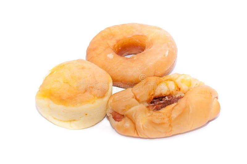 Pan di Spagna filippino di Mamon, guarnizioni di gomma piuma lustrate e piz italiano della salsiccia fotografie stock libere da diritti