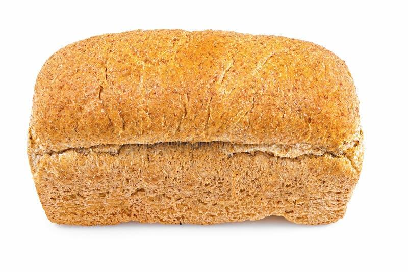 Pan entero del pan del grano en un fondo blanco foto de archivo libre de regalías