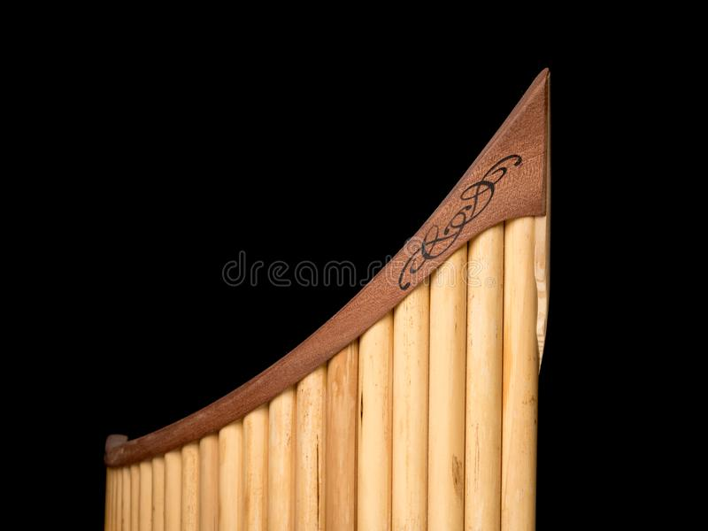 Pan flute in front of black background royalty free stock photos