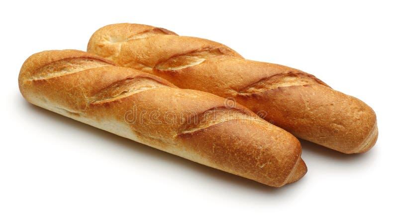 Pan francés, Baguette en el fondo blanco imágenes de archivo libres de regalías