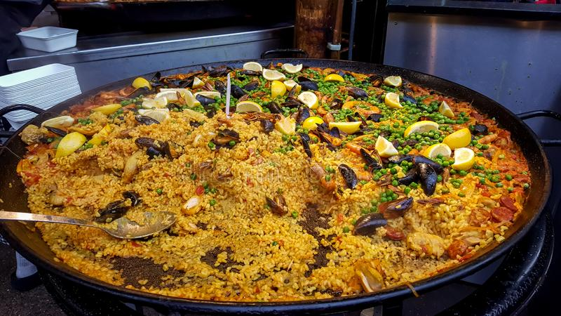 Fresh traditional paella ready in a marketplace royalty free stock images