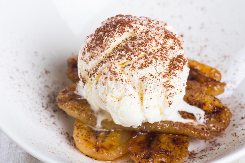 Pan fried banan with vanilla ice cream royalty free stock images