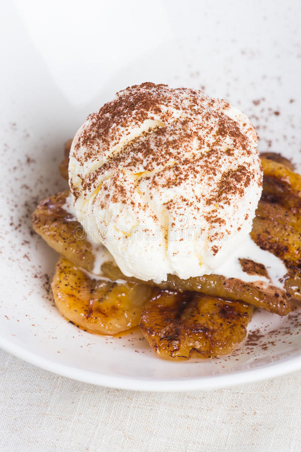Pan fried banan with vanilla ice cream royalty free stock photos