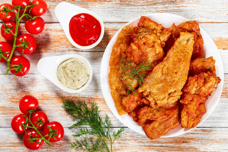 Pan fried Beer Battered fish fillets royalty free stock photography