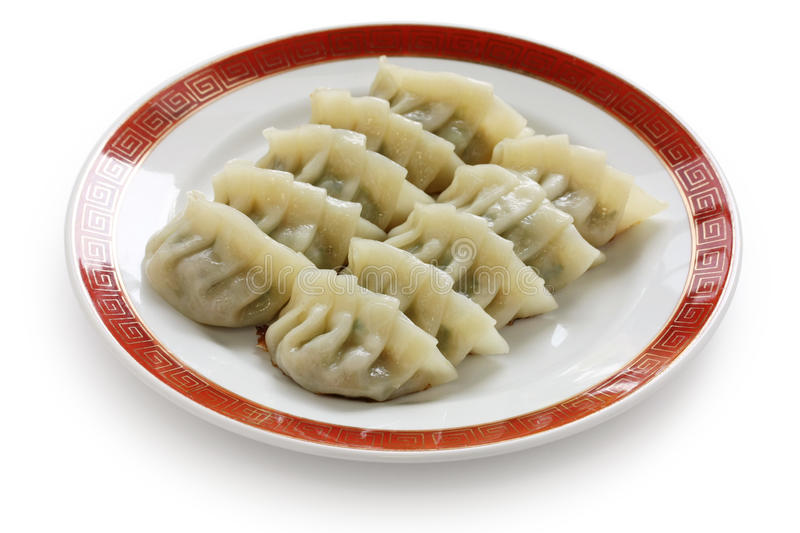 Pan fried chinese dumplings. On white background stock photography