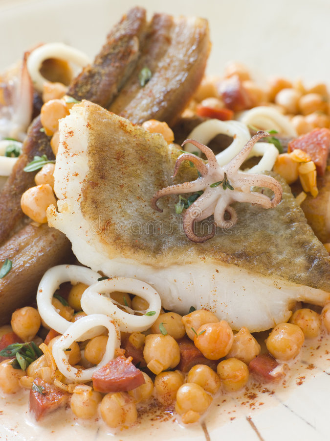 Pan Fried Cod Fillet And Baby Squid With Beans Stock Image