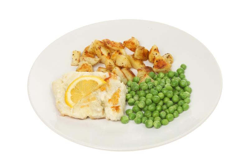 Pan fried cod. With saute potatoes and peas on a plate isolated against white stock photos