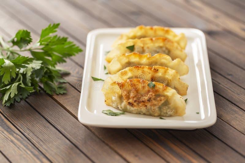 Pan Fried Dumpling, con la salsa Alimento asiático fotografía de archivo libre de regalías