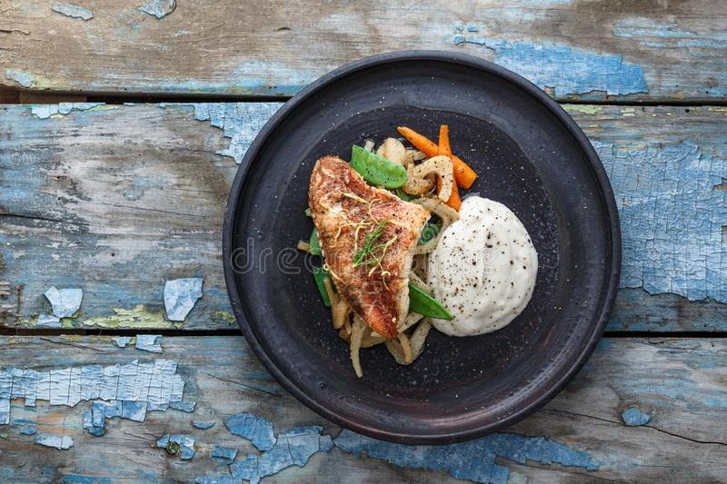 Pan fried ocean perch with sauteeed fennel and jerusalem artishoke puree, copy space.  royalty free stock photography