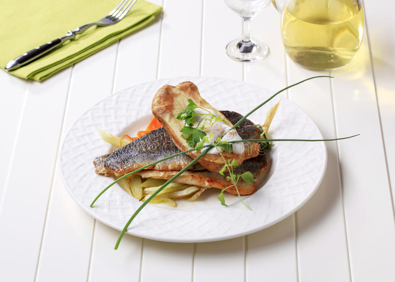 Pan-fried trout fillets with baked potato stock photography