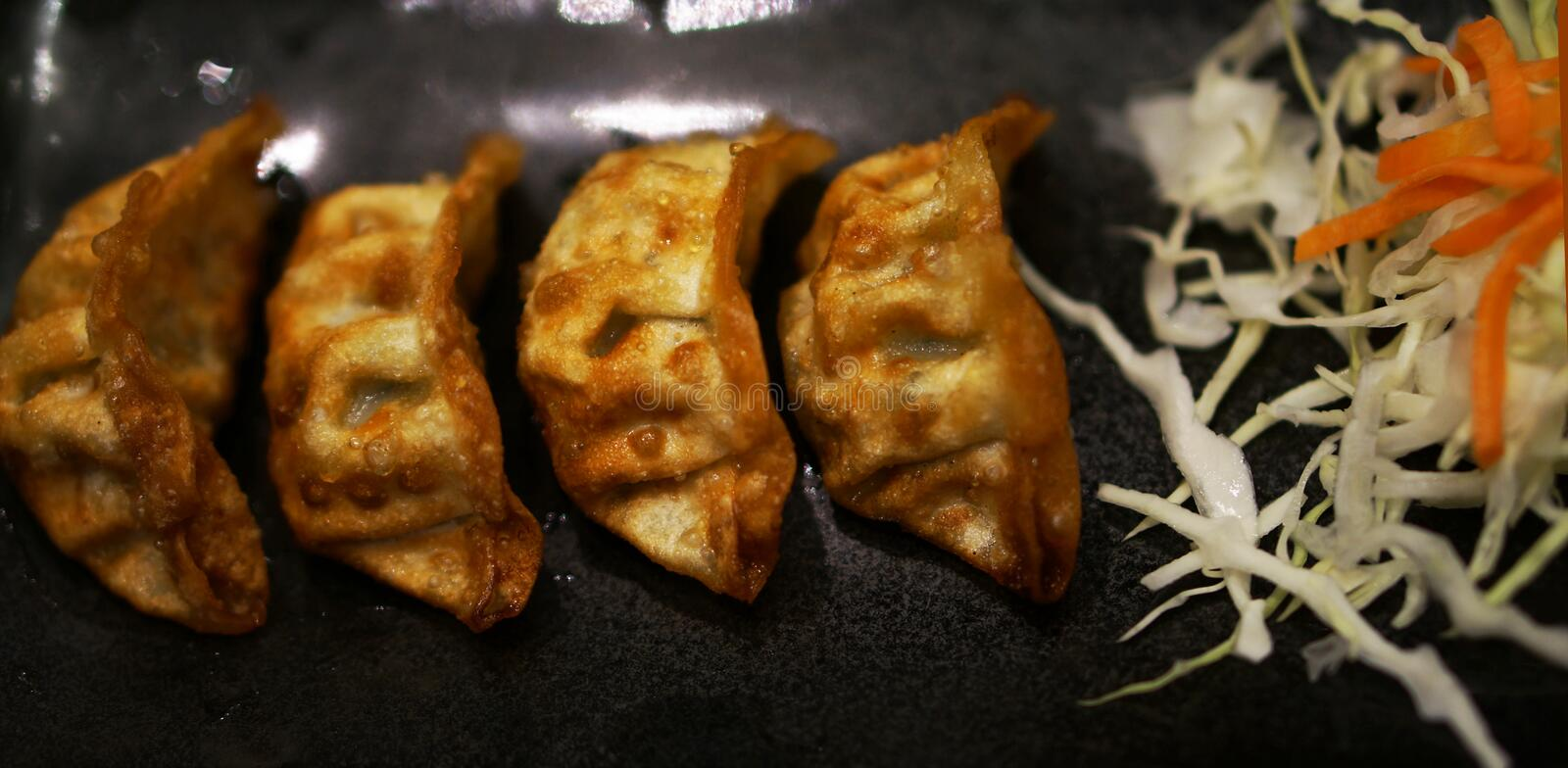 Pan fried vegetarian dumpling. Fried dumplings were beautifully arranged on the plate and very appetizing royalty free stock images