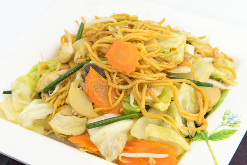 Pan Fried Yellow Chinese noodle call. Chow mein contains cabbages, bamboo shoots, baby corn,straw mushrooms,carrots,celery,bean sprouts royalty free stock images