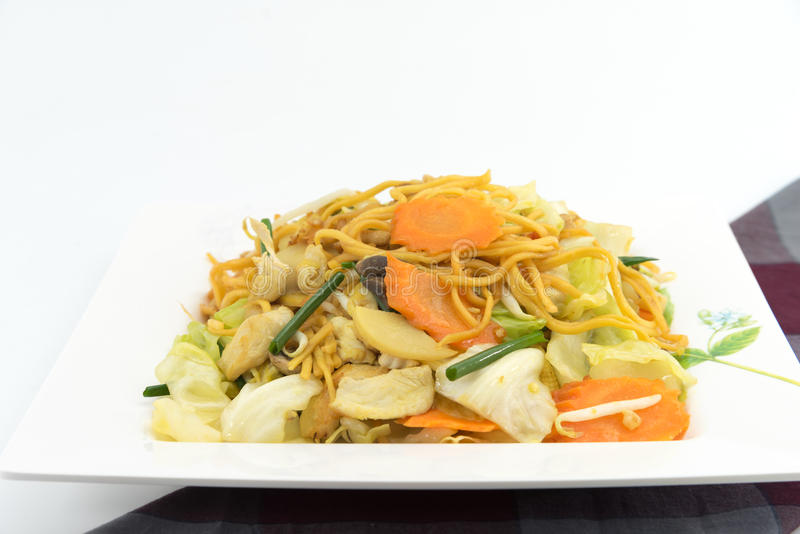 Pan Fried Yellow Chinese noodle call. Chow mein contains cabbages, bamboo shoots, baby corn,straw mushrooms,carrots,celery,bean sprouts stock images
