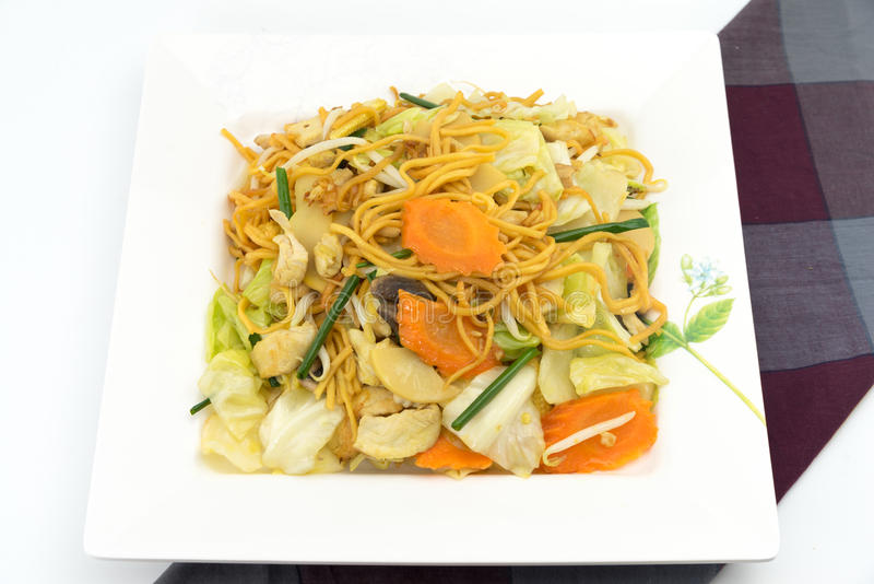 Pan Fried Yellow Chinese noodle call. Chow mein contains cabbages, bamboo shoots, baby corn,straw mushrooms,carrots,celery,bean sprouts royalty free stock photo
