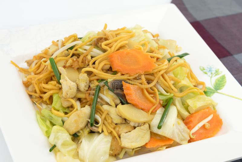 Pan Fried Yellow Chinese noodle call. Chow mein contains cabbages, bamboo shoots, baby corn,straw mushrooms,carrots,celery,bean sprouts royalty free stock image