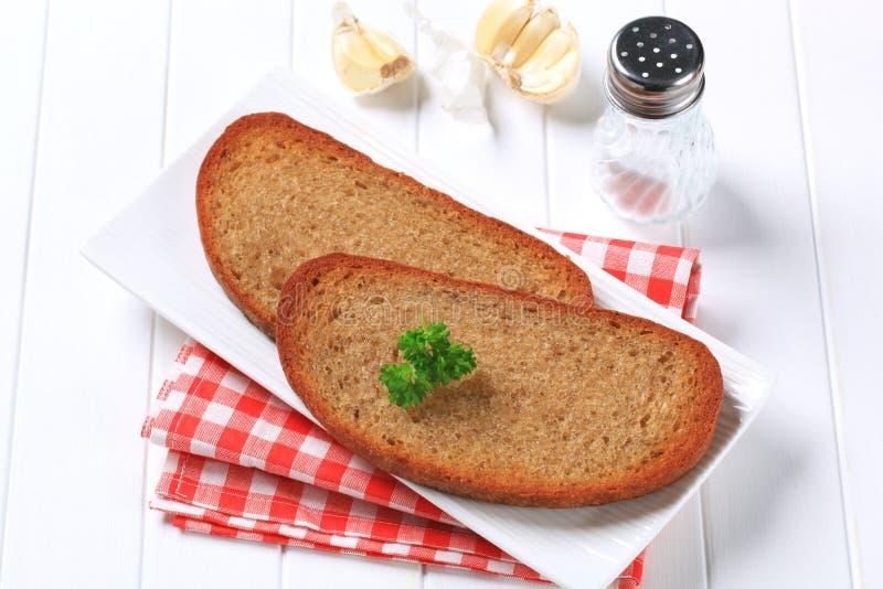 Pan frito y ajo de la cacerola fotografía de archivo libre de regalías