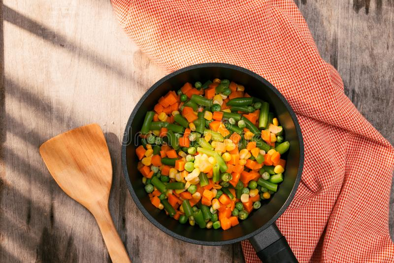 Pan with frozen vegetable mix for frying. Studio Photo stock photos