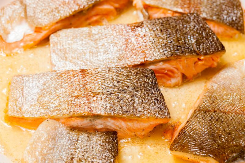 Pan frying red trout fillets, also known as arctic char.  royalty free stock image