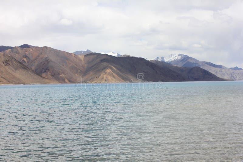Pan gong lake in Himalayas at 4350 meters, India. High grassland lake, with mountains royalty free stock photo